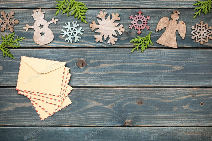 Christmas decoration and retro style envelopes on wooden background