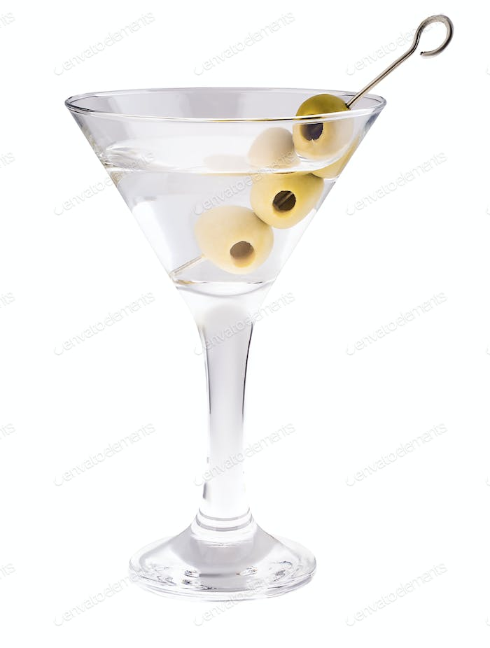Delicious cocktail with olives in martini glass on a white background.