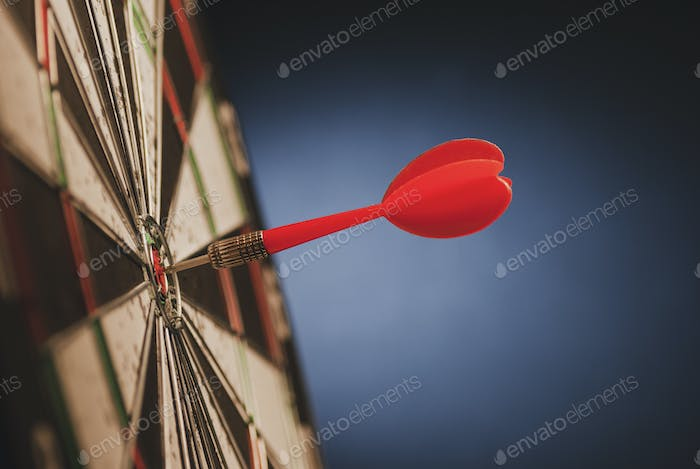 Red dart in the center of a target