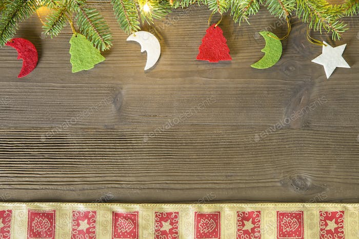 Christmas decorations of felt on a wooden top seen from above