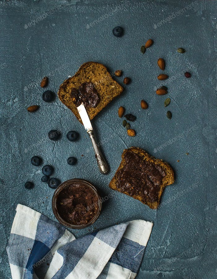 Whole grain bread toasts with organic vegan chocolate peanut butter