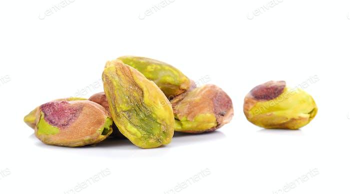 Pistachio nuts on white background.