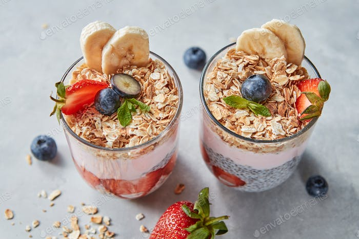 Dietary natural breakfast with natural organic ingredients - strawberries, granola, banana in a