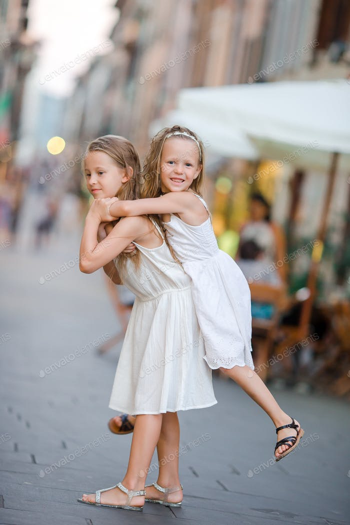 Pretty smiling little girls with shopping bags