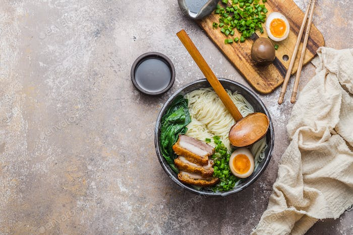Ramen bowl with pork, pak choi and egg, flat lay