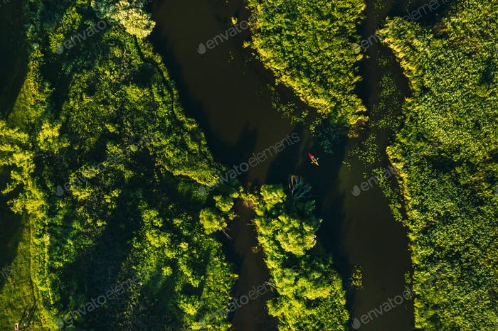 Top view of the Svisloch river in the Park and a kayaker at sunset in Minsk.Beautiful nature of