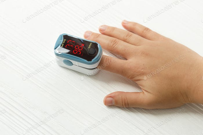Pulse Oximeter on finger, measuring blood oxygen level, detecting coronavirus pneumonia
