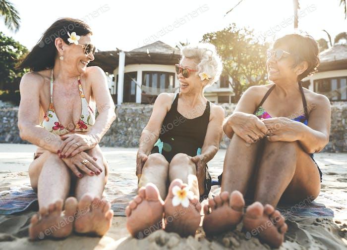 Senior women friends on the beach
