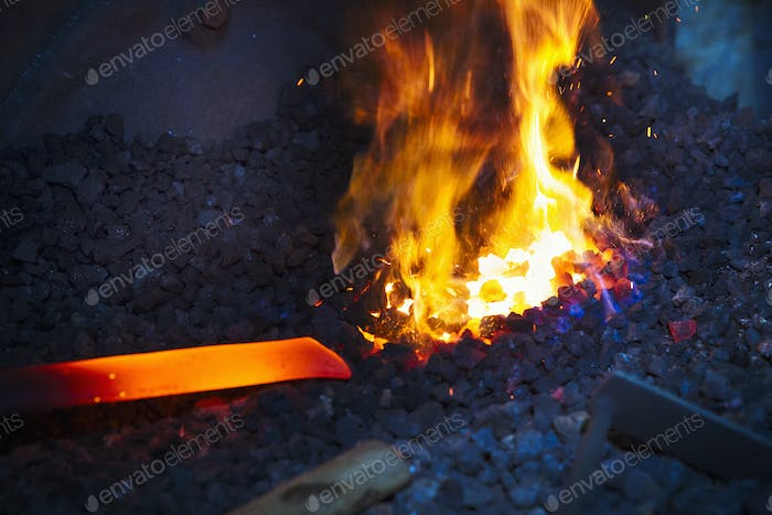 A length of red hot metal in a furnace.