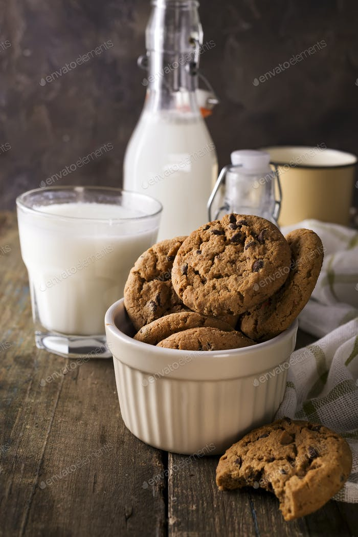 fresh healthy milk and cookies on a rustic wood background,