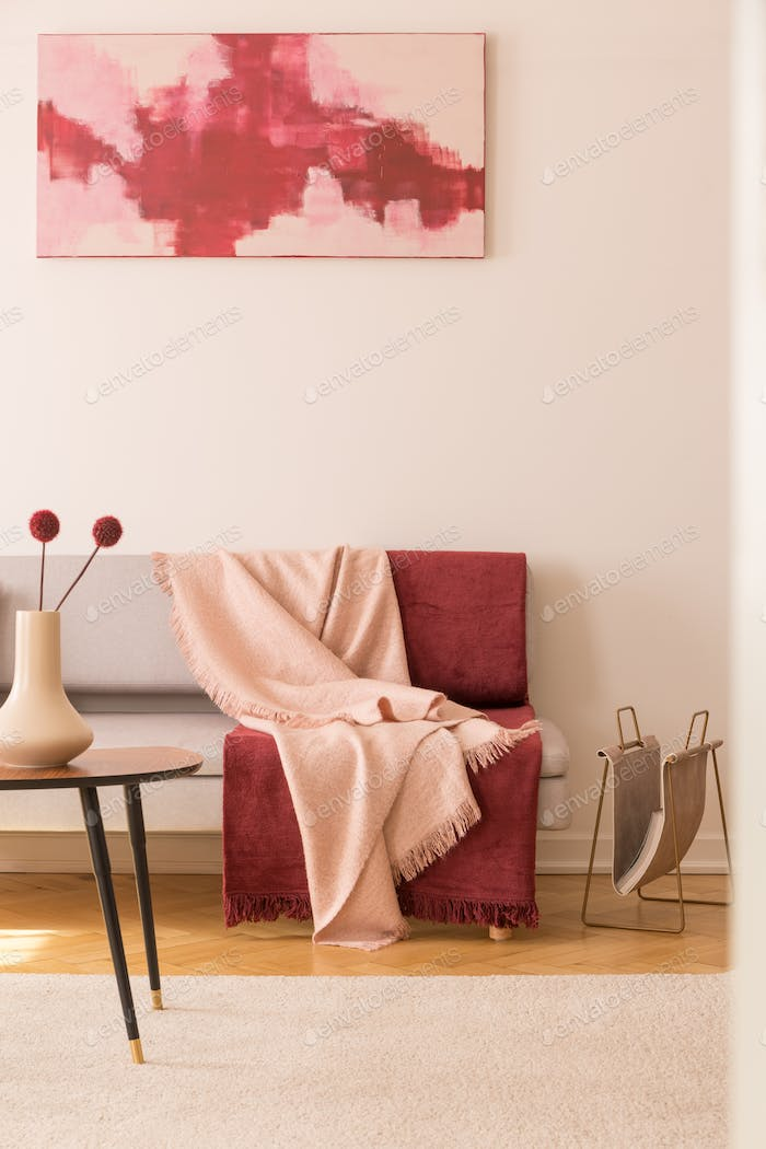 Abstract painting on the empty white wall of elegant living room