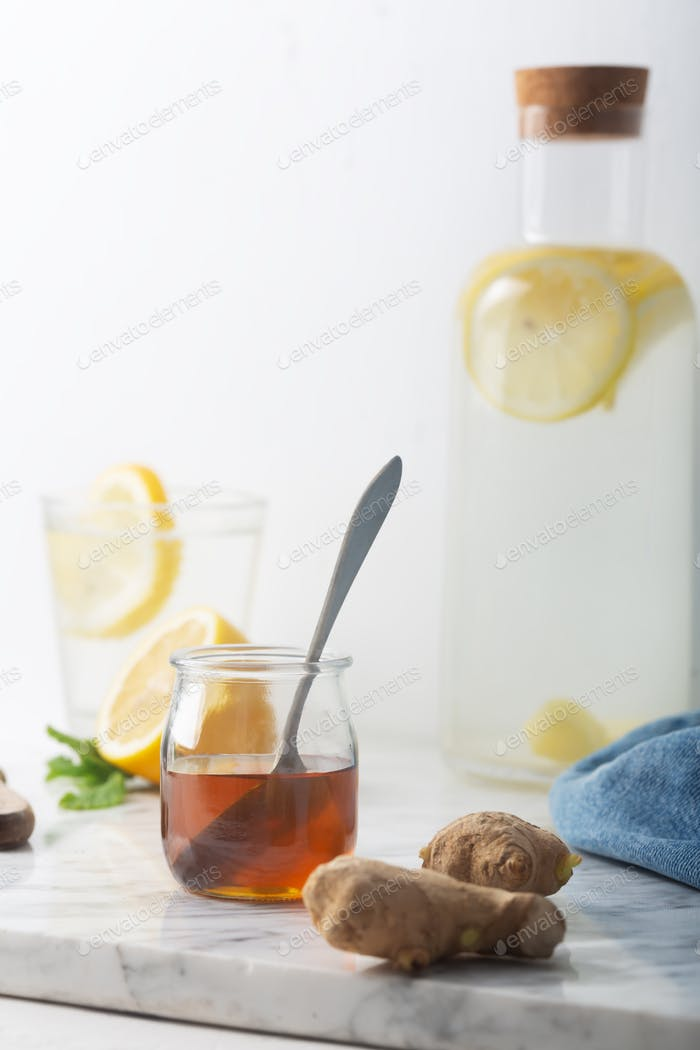 Honey and Other Ingredients of Ginger Water, Including Lemon and Mint, Vertical Orientation