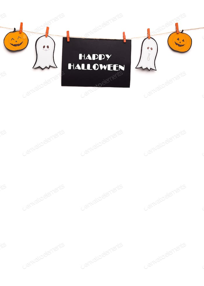 Creative Happy Halloween text hanging out on rope