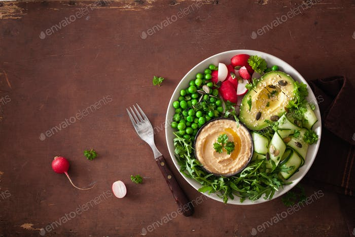 healthy vegan lunch bowl with avocaco cucumber hummus peas radish