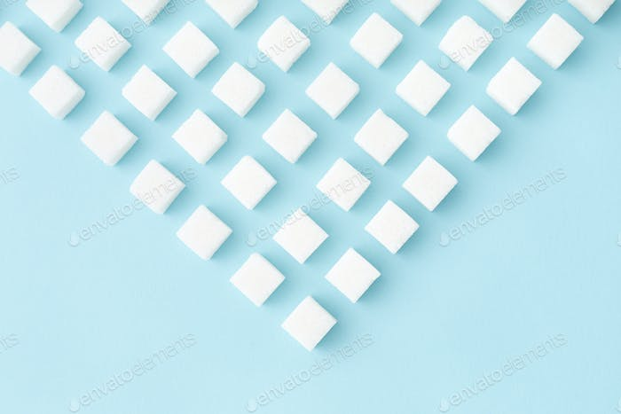 Sugar Cubes Geometry Pattern on Blue Background with Copy Space.