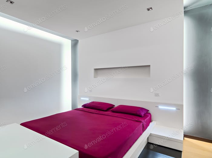 Interiors of the Modern Bedroom with Wood Floor