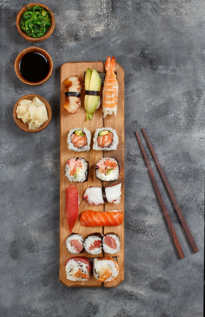 Sushi Set nigiri and sushi rolls on a wooden tray