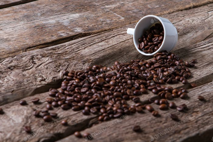 Roasted coffee beans and cup