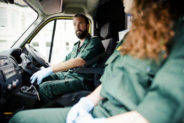 Paramedic man driving an ambulance