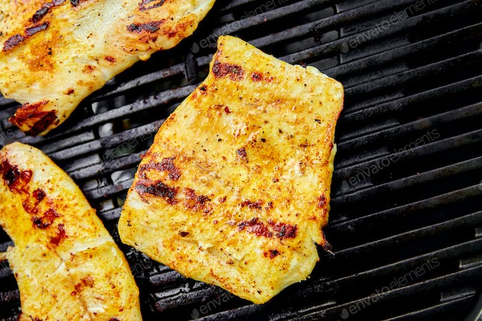 Grilled pike fillet on the gas grill.