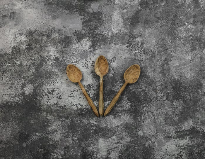 three wood spoon with grunge background