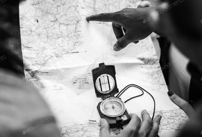 People using compass in black and white