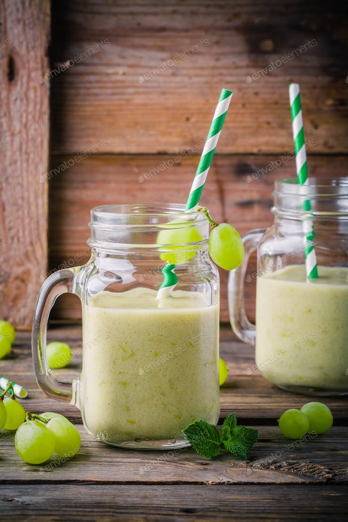 green organic detox grape smoothie in glass mason jar on  wooden background