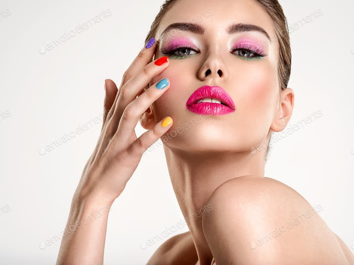 Beautiful fashion woman with a colored nails.