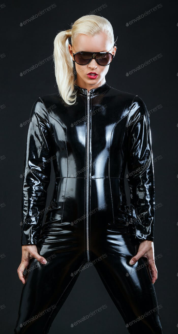 Awesome blond woman in latex costume