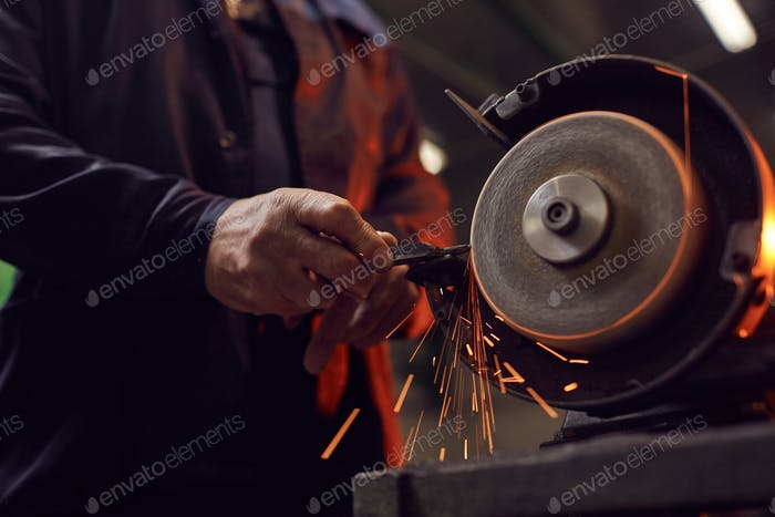 Worker working on grinder
