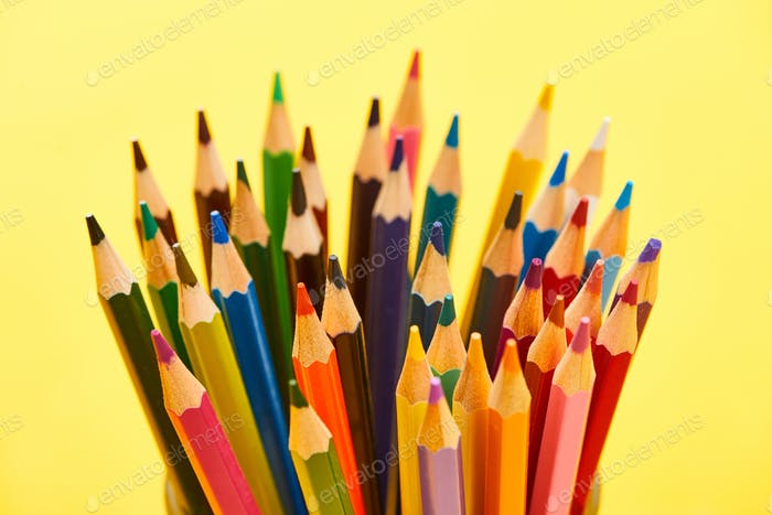Sharpened And Bright Color Pencils Isolated on Yellow