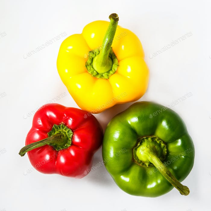 Fresh peppers. Three sweet Red, Yellow, Green Peppers isolated on white background. Top view