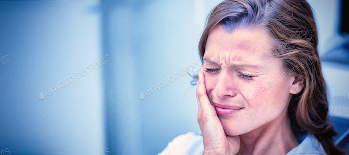 Unhappy woman having a toothache