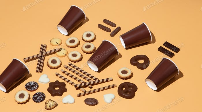 Chocolate cookies and plastic cap background. Winter holiday time. Minimal