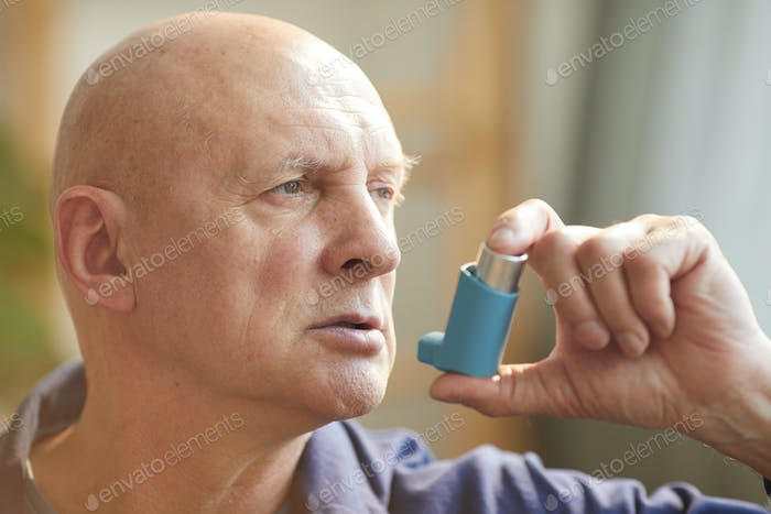 Senior Man Using Inhaler