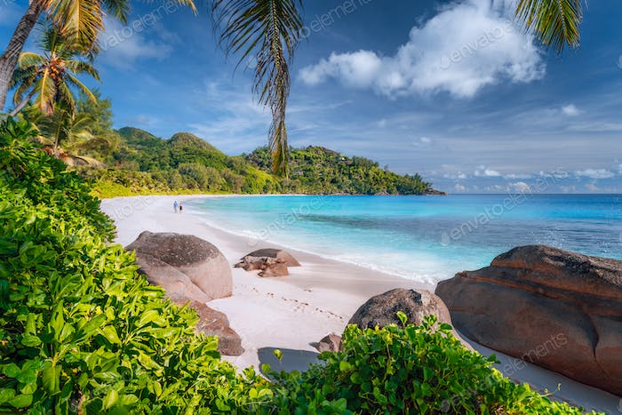 Lonely couple on beautiful exotic Anse Intendance beach on Mahe island, Seychelles