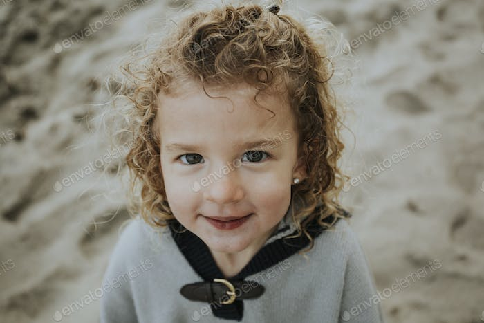 A young curly haired girl