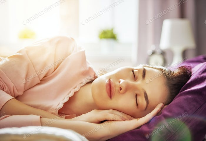 woman sleeping sunny morning
