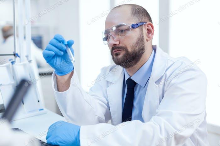 Genetic scientist conducting pharmacology exepriment