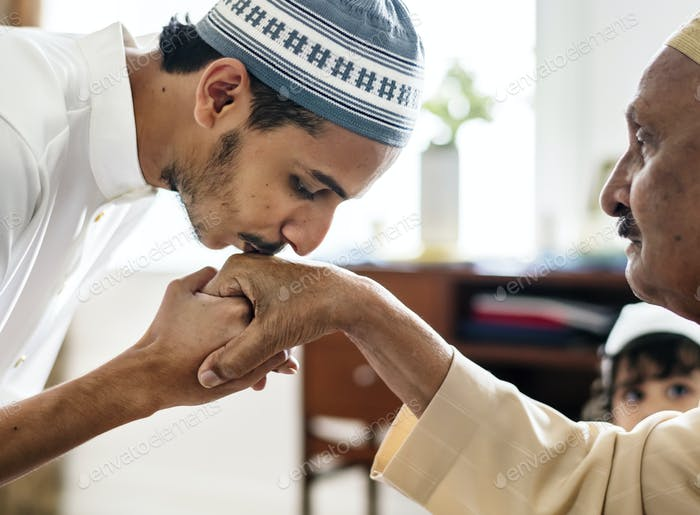Muslim son kisses his father's hands