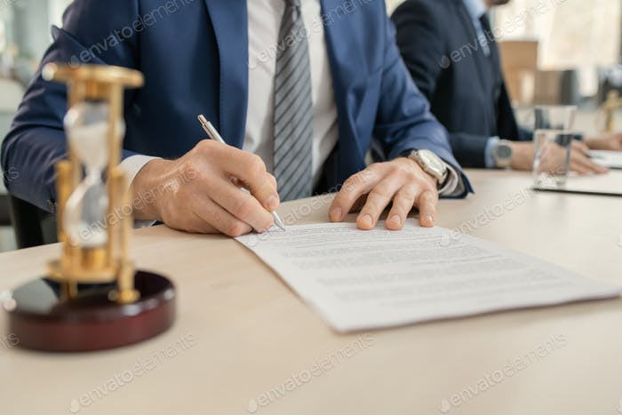 Businessman signing a contract at office