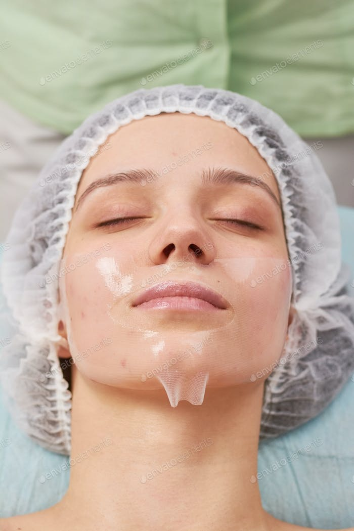 Young woman, collagen mask