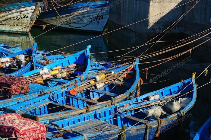 Blue boats in a port