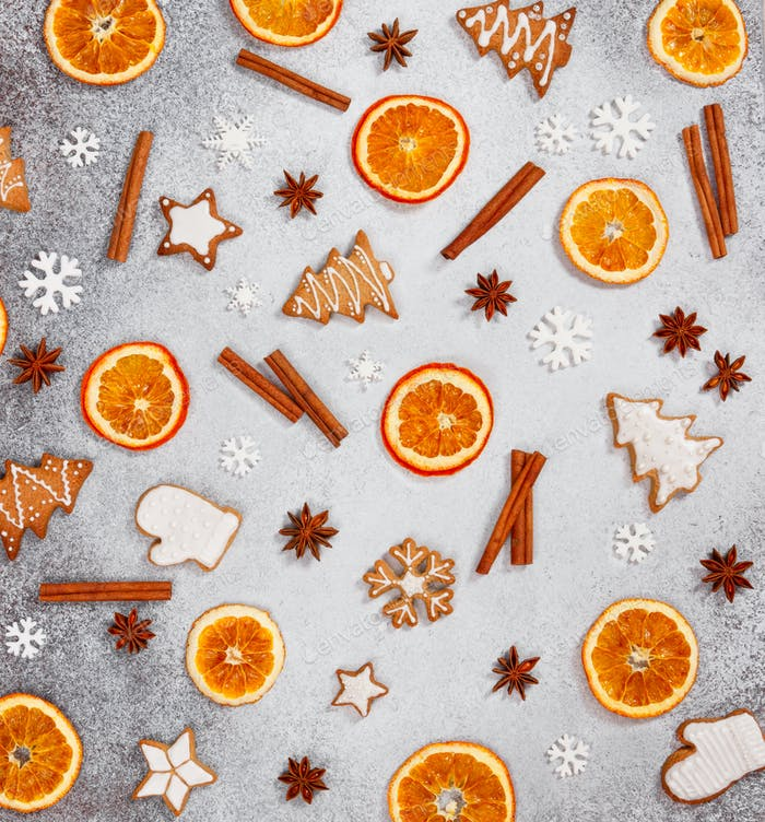 Christmas ginger cookies, dried orange, cinnamon,  and star anise on gray stone background.
