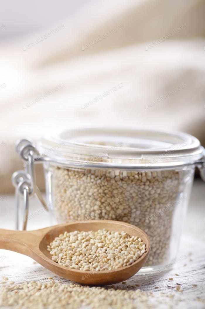 organic superfood gluten free quinoa seeds in wooden spoon