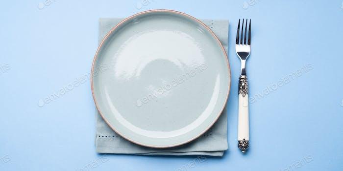 Blue pastel ceramic dish on napkin with fork