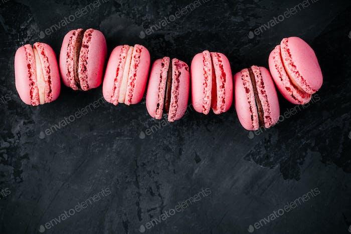 Valentines day pink cake macarons on dark background