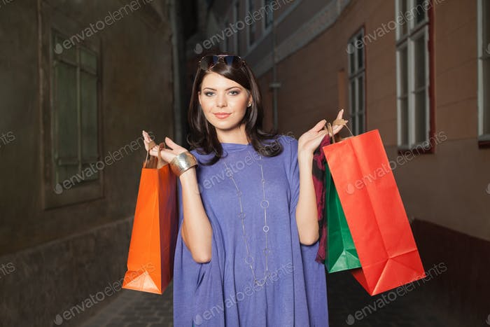 woman holding colorful bags