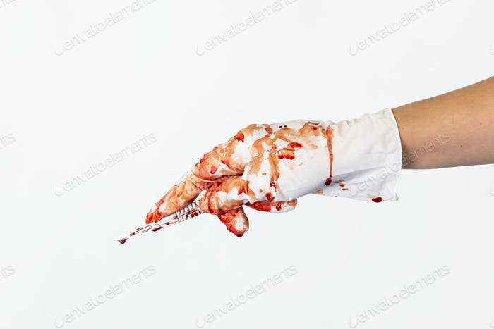 Bloody scalpel in a surgical hand