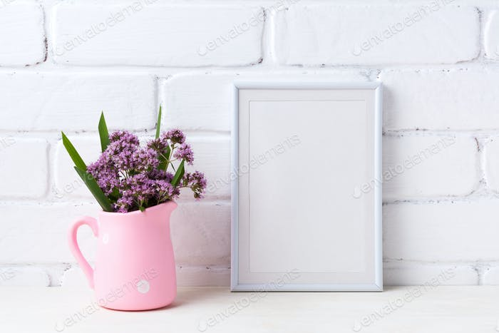 White frame mockup with purple flowers in pink rustic pitcher
